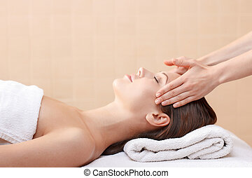 Professional spa specialist making massage