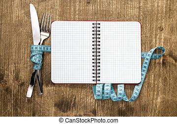 besteck, gebunden, mit, messendes klebeband, und, leer, notizbuch