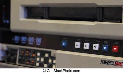 Betacam Rewind in TV Sudio - TV studio employee working with...