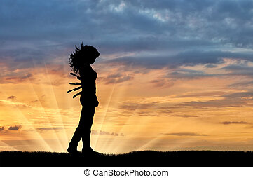 Silhouette of a sad woman with a knives in his back