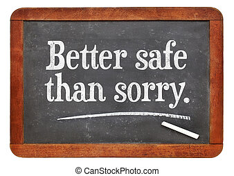 Better safe than sorry proverb - white chalk text on a ...