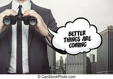 Better things are coming text on blackboard with businessman