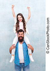Better together. Happy family celebrating fathers day. Small daughter and father enjoy celebrating holidays. Hipster carry child piggyback. Holiday celebration. Happy celebrating. Keep celebrating
