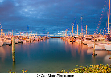 Marina at night, Tauranga New Zealand. - Between cloud layer...