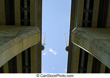 Between pair of concrete bridges on sky