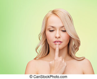 beutiful young woman touching her lips