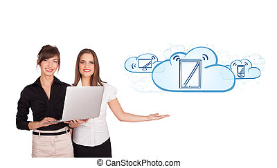 Beutiful young women presenting modern devices in clouds