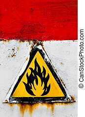 Beware of fire sign on rusty metal