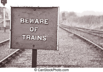 Beware of Train Warning Sign in Black and White Sepia Tone