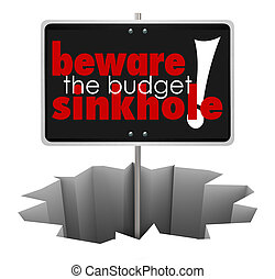 Beware the Budget Sinkhole words on a sign in a hole, crack or chasm to symbolize money trouble, financial shortfall or bankruptcy