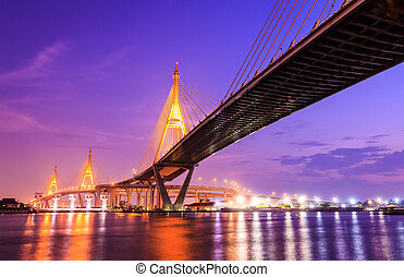 Bhumibol huge industrial bridge at dusk in Samut Prakarn...