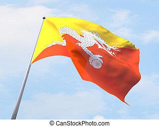 Bhutan flag flying on clear sky.