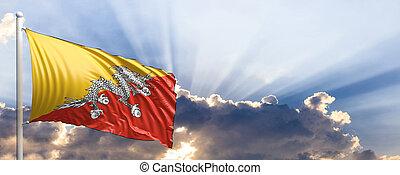 Bhutan flag on blue sky. 3d illustration