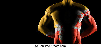 Bhutan flag on muscled male torso with abs