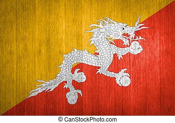 Bhutan Flag on wood background