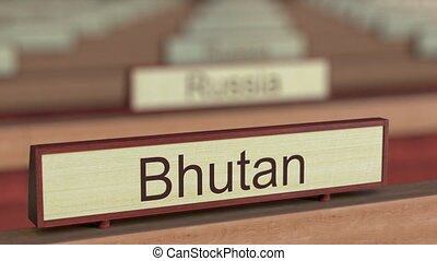 Bhutan name sign among different countries plaques at...