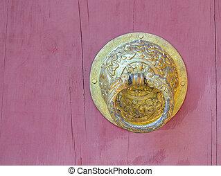 bhutan style metal door knob on wooden background