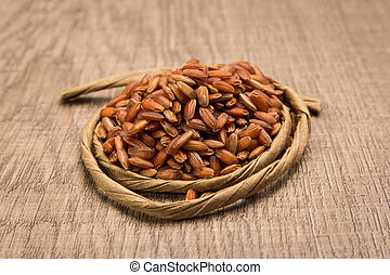 Bhutanese Red Rice seed. Paper rope around grain. Selective focus.