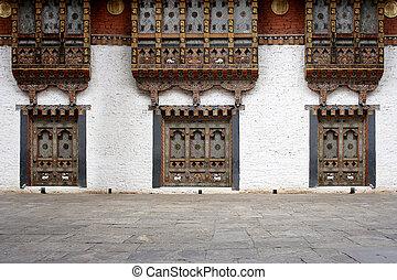 Bhutanese windows in the Temple of Bhutan.