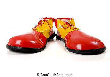 białe obuwie, klown