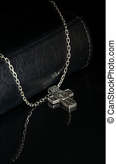 bible and crucifix on a black background