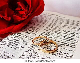Bible and wedding rings - Closeup of Bible & wedding rings...