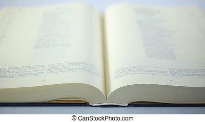 Bible Book scrolling fast.