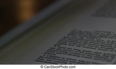 Bible-Daniel - A slow, shallow depth of field, candle lit...
