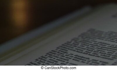 Bible-Joel - A slow, shallow depth of field, candle lit pan...