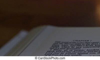 Bible-Micah - A slow, shallow depth of field, candle lit pan...