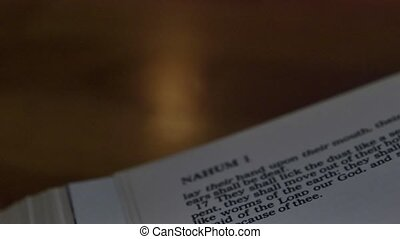 Bible-Nahum - A slow, shallow depth of field, candle lit pan...