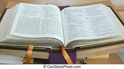Open bible on a table in a church.