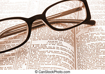 Bible open to Psalm 23, with reading glasses.