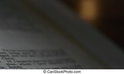 Bible Philemon - A slow, shallow depth of field, candle lit...