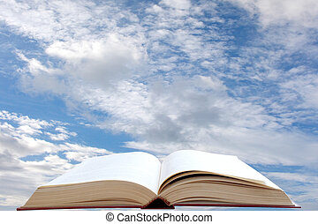 Bible - Open book and sky background
