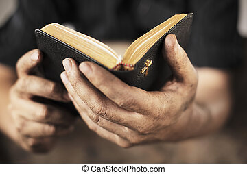 Bible - Dirty hands holding an old bible. Very short...