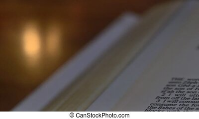 Bible-Zephaniah - A slow, shallow depth of field, candle lit...