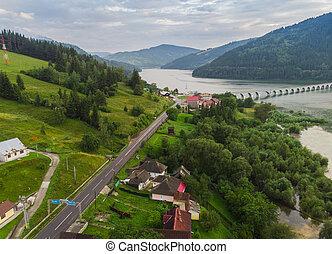Bicaz lake and road, aerial view. Romania