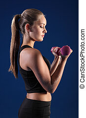 Bicep curl by beautiful young fitness woman