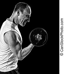 Bicep Curl - Bicep curl exercise with dumbbell. Studio shot...