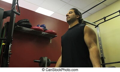 Bicep Curls (2 Shots) - 2 shots in one. A man with large...