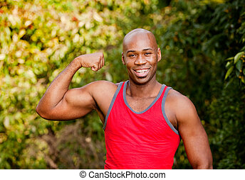 Bicep Muscle - An African American man flexing his Bicep
