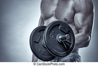 Biceps curl with dumbbell on grey background