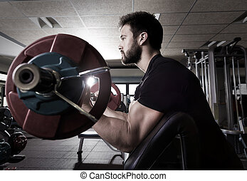 biceps preacher bench arm curl workout man at gym