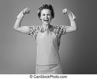 biceps, vrouw, het tonen, jonge, rubberhandschoen, vrolijke