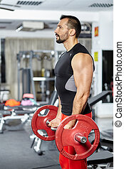 Biceps workout with barbell