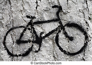 Bicicle silhouette painted on a tree bark.