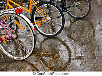 bicicletas, chuva