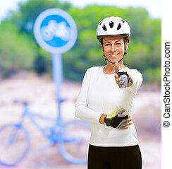 biciklista, kiállítás, nő, lapozgat feláll