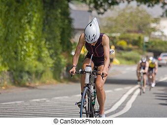 biciklista, női